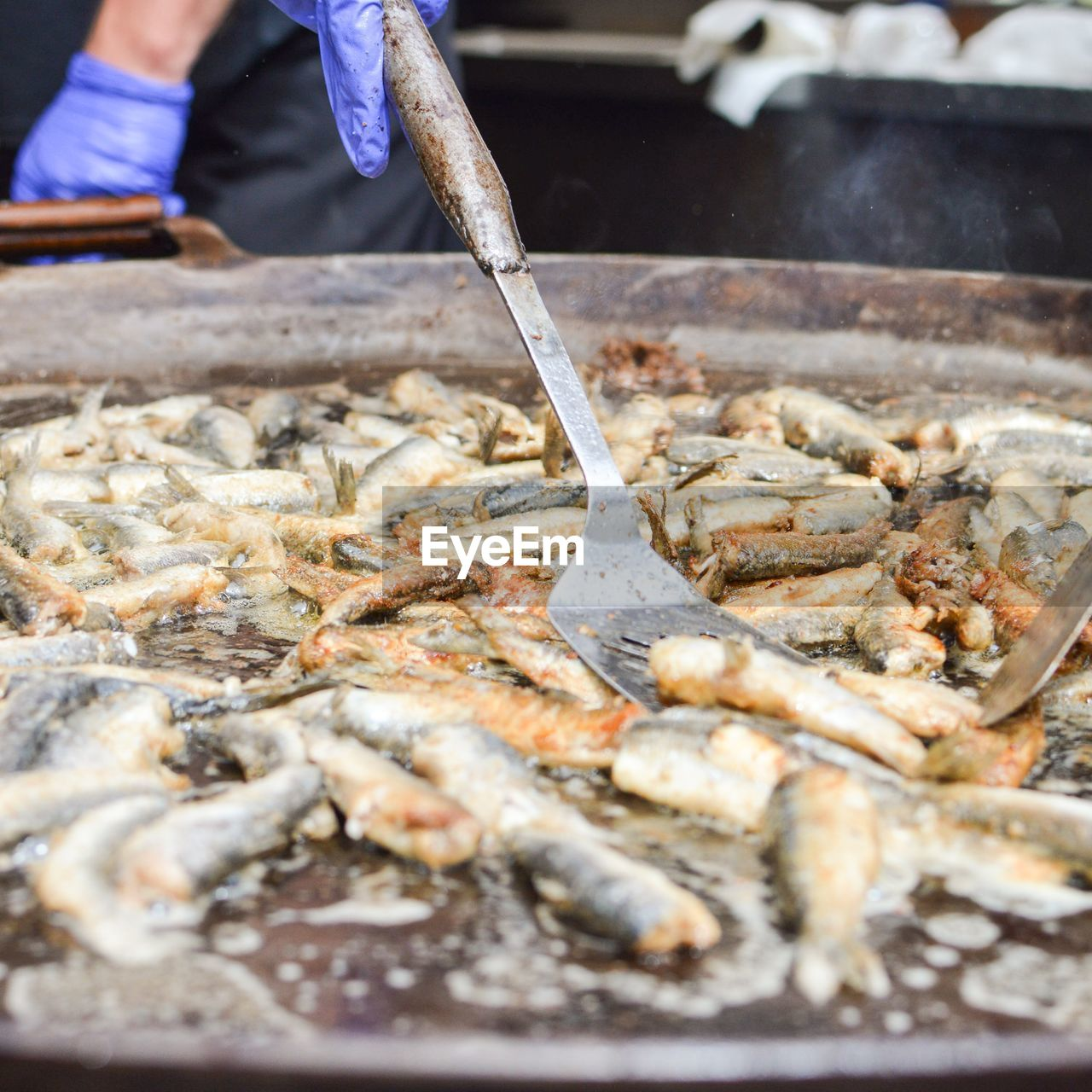 food, food and drink, freshness, seafood, preparation, one person, real people, preparing food, fish, human hand, hand, working, market, kitchen utensil, occupation, vertebrate, wellbeing, holding, healthy eating, chef