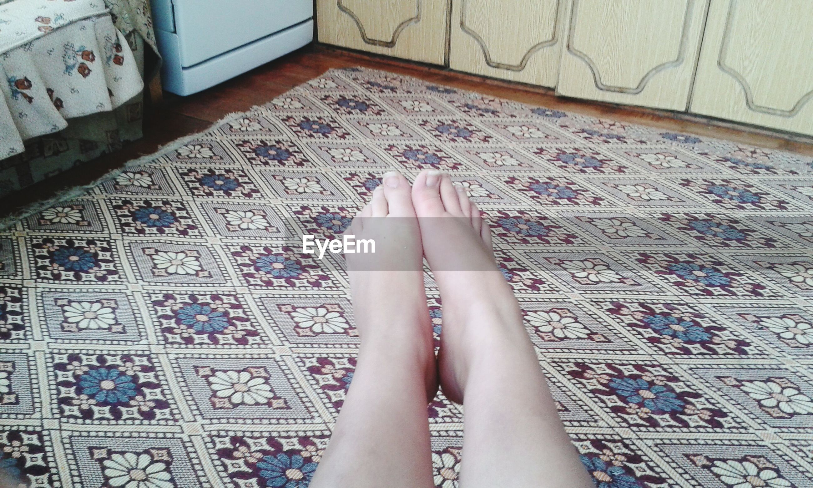 low section, person, personal perspective, human foot, barefoot, lifestyles, indoors, part of, high angle view, leisure activity, standing, relaxation, shoe, legs crossed at ankle, human limb