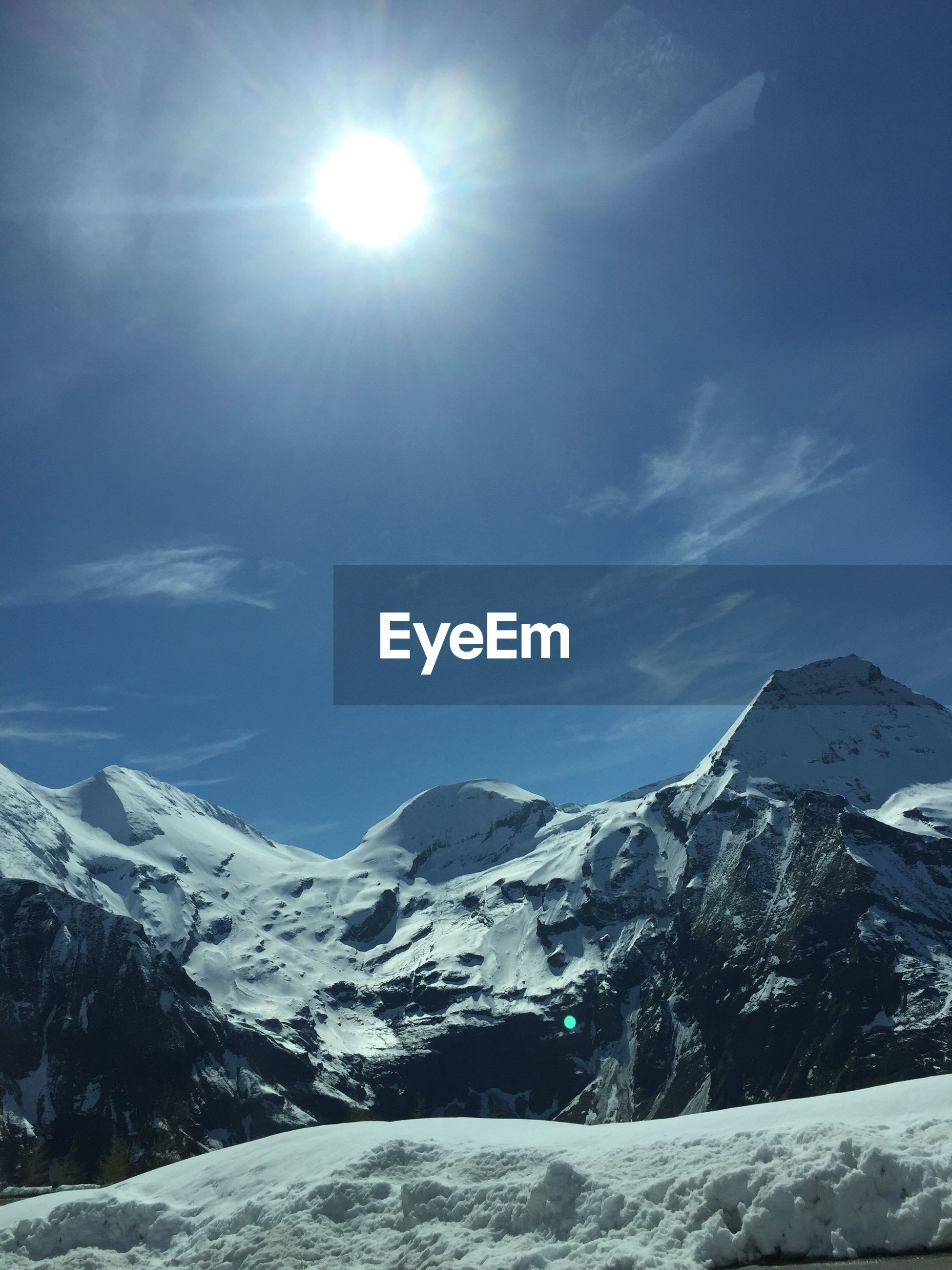 snow, snowcapped mountain, sky, mountain, beauty in nature, scenics, winter, mountain range, cold temperature, nature, sun, sunlight, tranquil scene, idyllic, tranquility, low angle view, outdoors, no people, day