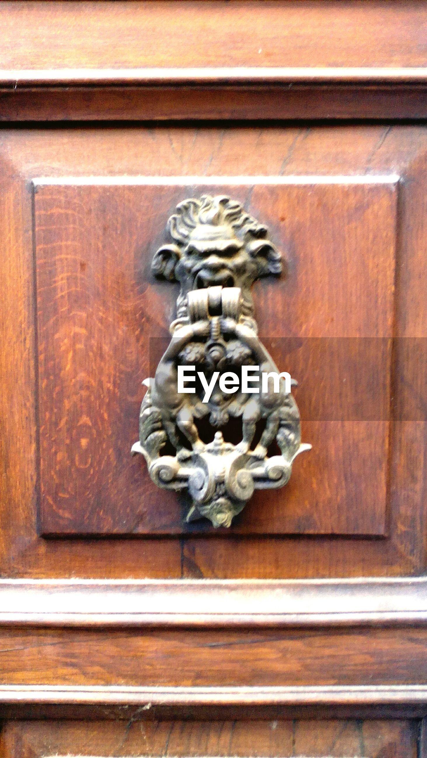 CLOSE-UP OF STATUE ON DOOR