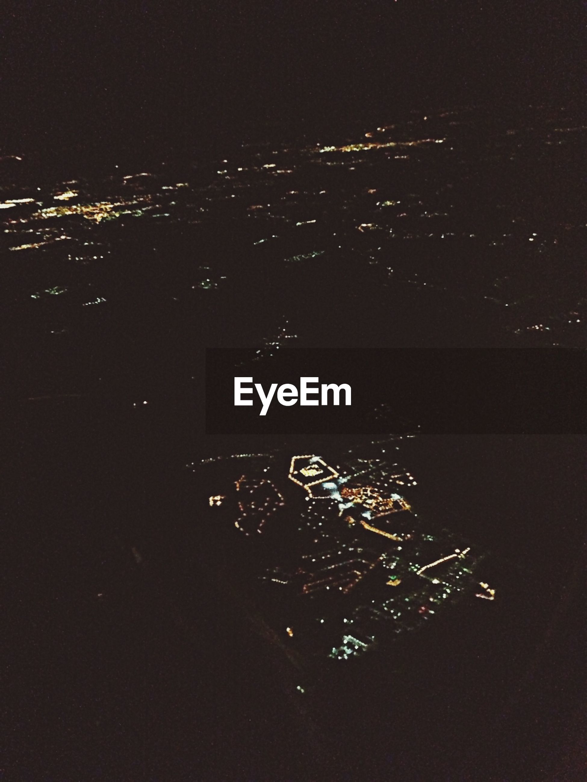 night, illuminated, communication, text, high angle view, western script, dark, indoors, technology, no people, city, cityscape, light - natural phenomenon, lighting equipment, electricity, building exterior, copy space, capital letter, built structure