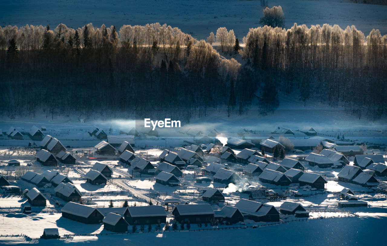 water, cold temperature, snow, high angle view, winter, nature, architecture, no people, day, built structure, beauty in nature, building exterior, outdoors, lake, sunlight, tree, scenics - nature, frozen