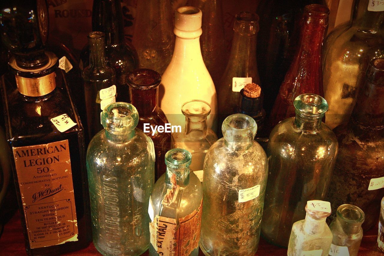 bottle, label, indoors, text, variation, no people, large group of objects, retail, close-up, day