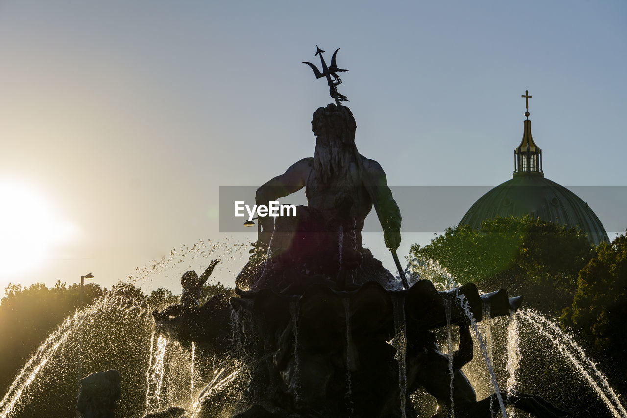 sky, sculpture, statue, human representation, representation, nature, art and craft, male likeness, water, architecture, fountain, clear sky, creativity, sunset, built structure, no people, sunlight, travel, travel destinations, outdoors, spraying
