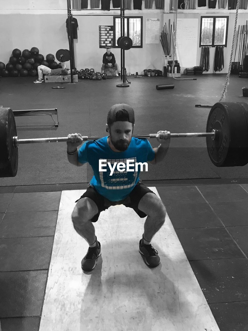 full length, one person, lifestyles, sport, real people, men, childhood, leisure activity, healthy lifestyle, front view, boys, males, child, strength, weight training, indoors, exercising, day