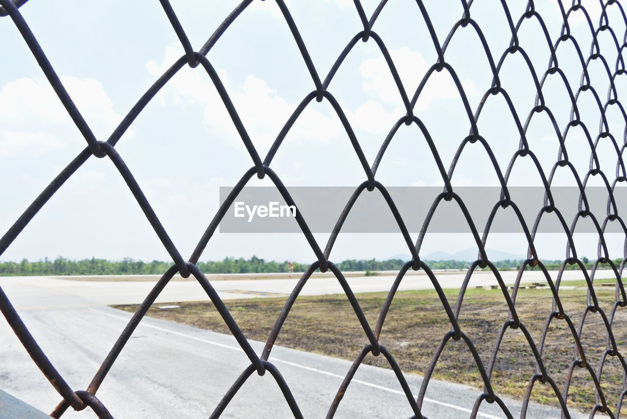 chainlink fence, fence, security, protection, safety, metal, sky, day, no people, boundary, nature, barrier, cloud - sky, field, land, pattern, full frame, outdoors, focus on foreground, landscape