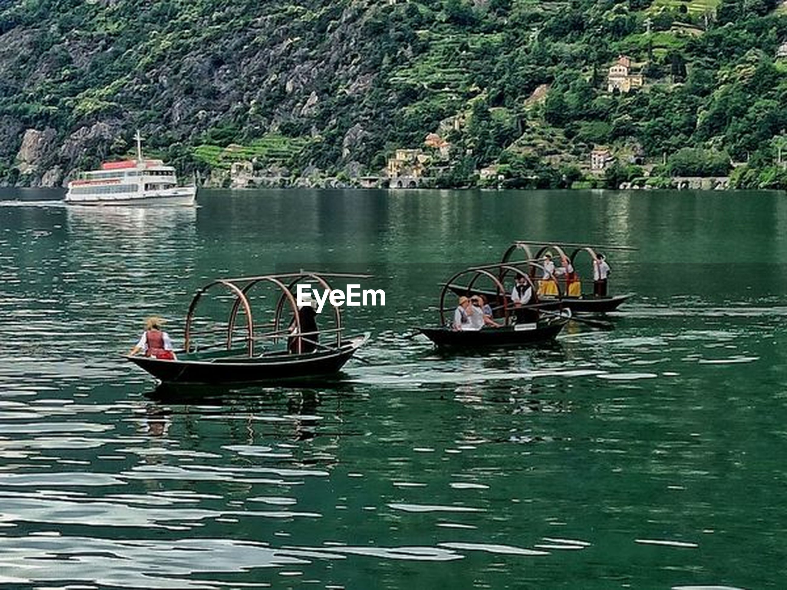 water, nautical vessel, transportation, mode of transportation, boating, boat, nature, vehicle, day, waterfront, travel, plant, tree, watercraft, lake, group of people, beauty in nature, outdoors, men, scenics - nature, tranquility, travel destinations, tourism, rippled, tranquil scene