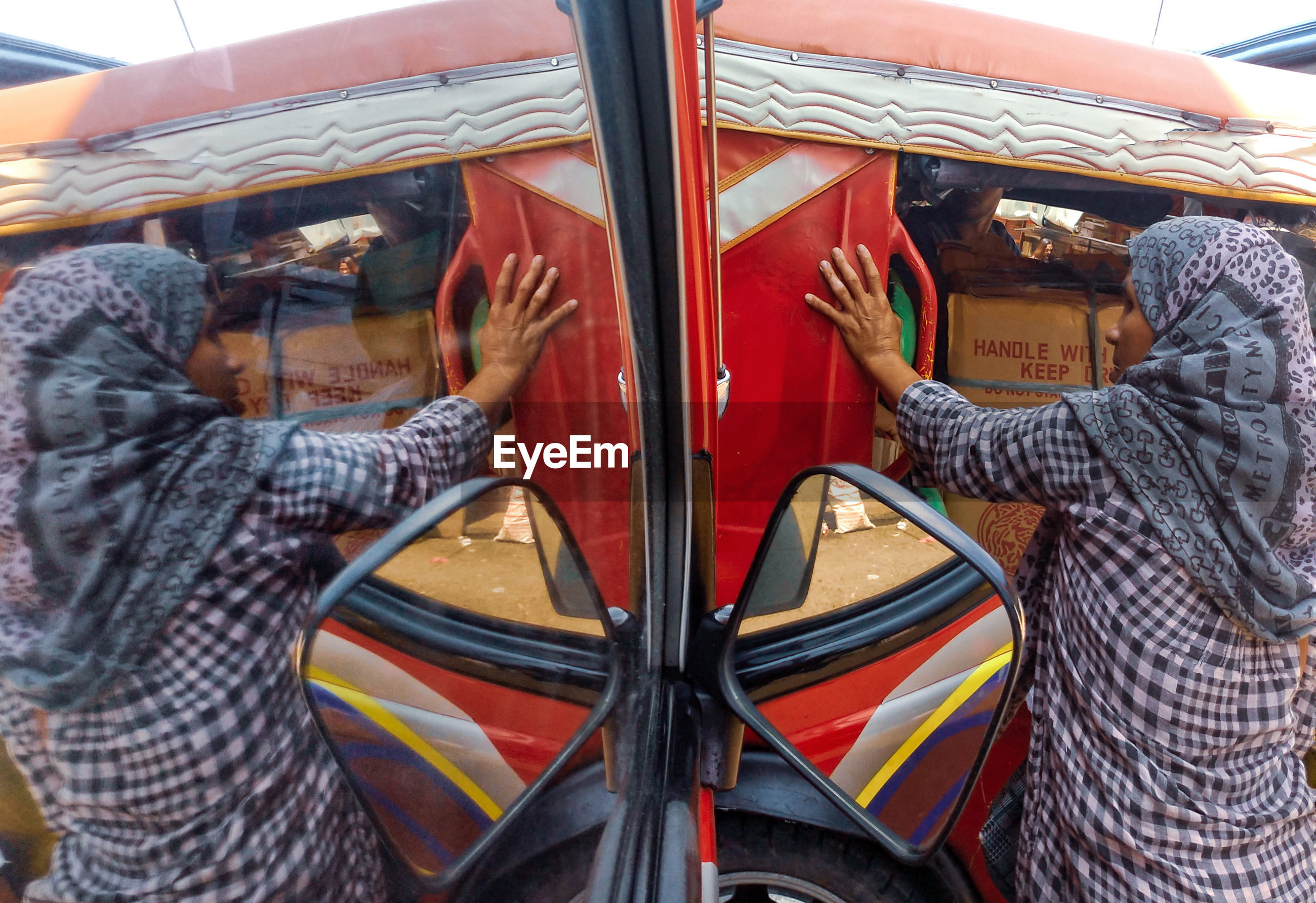 REAR VIEW OF MAN STANDING IN BUS