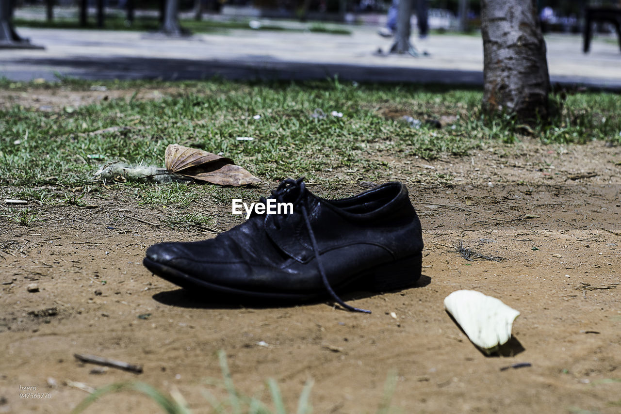 Close-up of shoes on ground