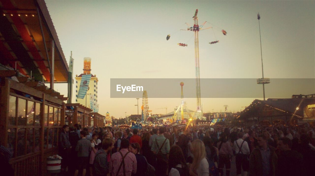 large group of people, city, real people, built structure, architecture, crowd, building exterior, men, outdoors, sky, day, people