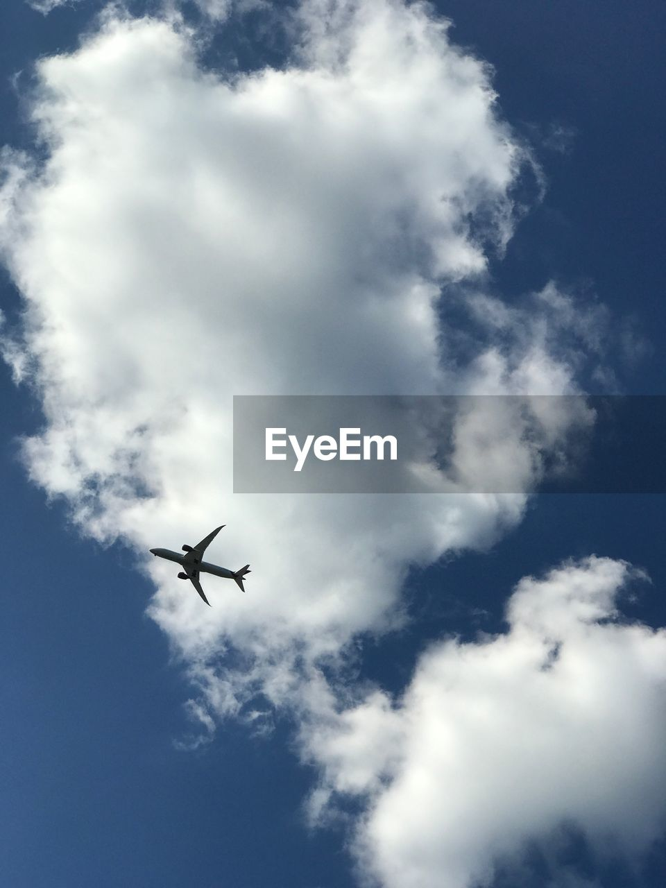 flying, low angle view, sky, airplane, cloud - sky, journey, travel, transportation, outdoors, day, no people, nature, vapor trail