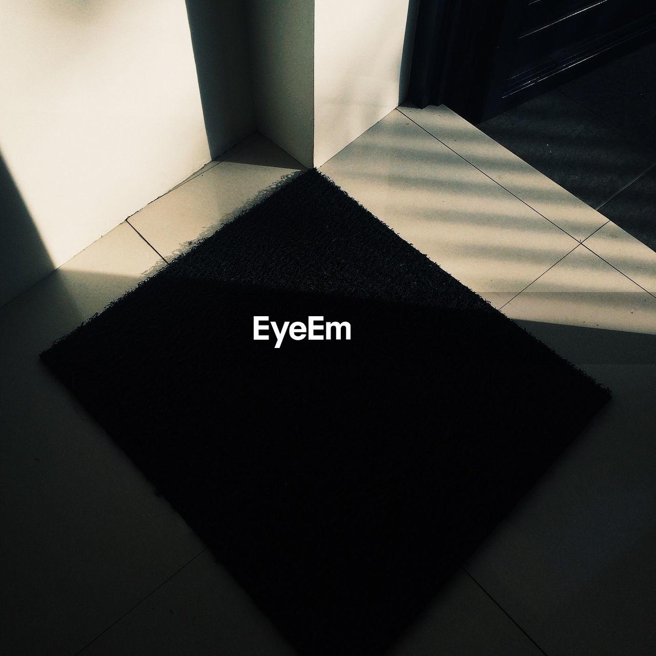 flooring, indoors, tiled floor, home interior, shadow, high angle view, no people, corridor, doorway, open door, day, geometry, close-up