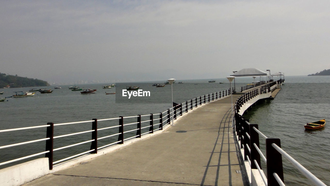 water, sky, sea, transportation, nature, railing, nautical vessel, scenics - nature, day, architecture, mode of transportation, built structure, pier, beauty in nature, no people, tranquility, outdoors, tranquil scene, bridge, horizon over water, cruise ship, promenade, passenger craft