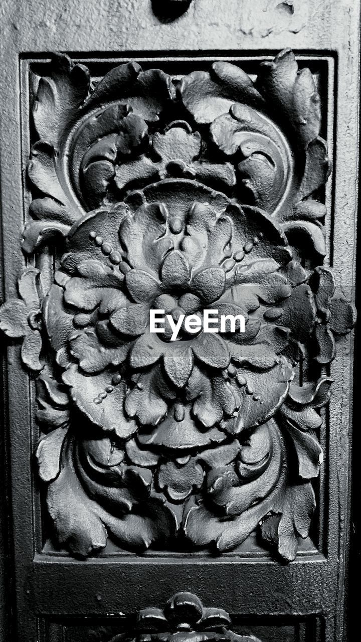 Close-up of floral pattern carved on wood