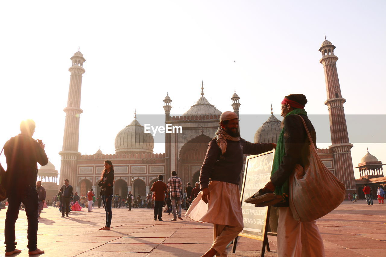 real people, tourism, architecture, built structure, travel destinations, dome, history, travel, large group of people, building exterior, men, vacations, lifestyles, religion, clear sky, monument, spirituality, day, architectural column, outdoors, leisure activity, place of worship, women, sky, ancient civilization, people