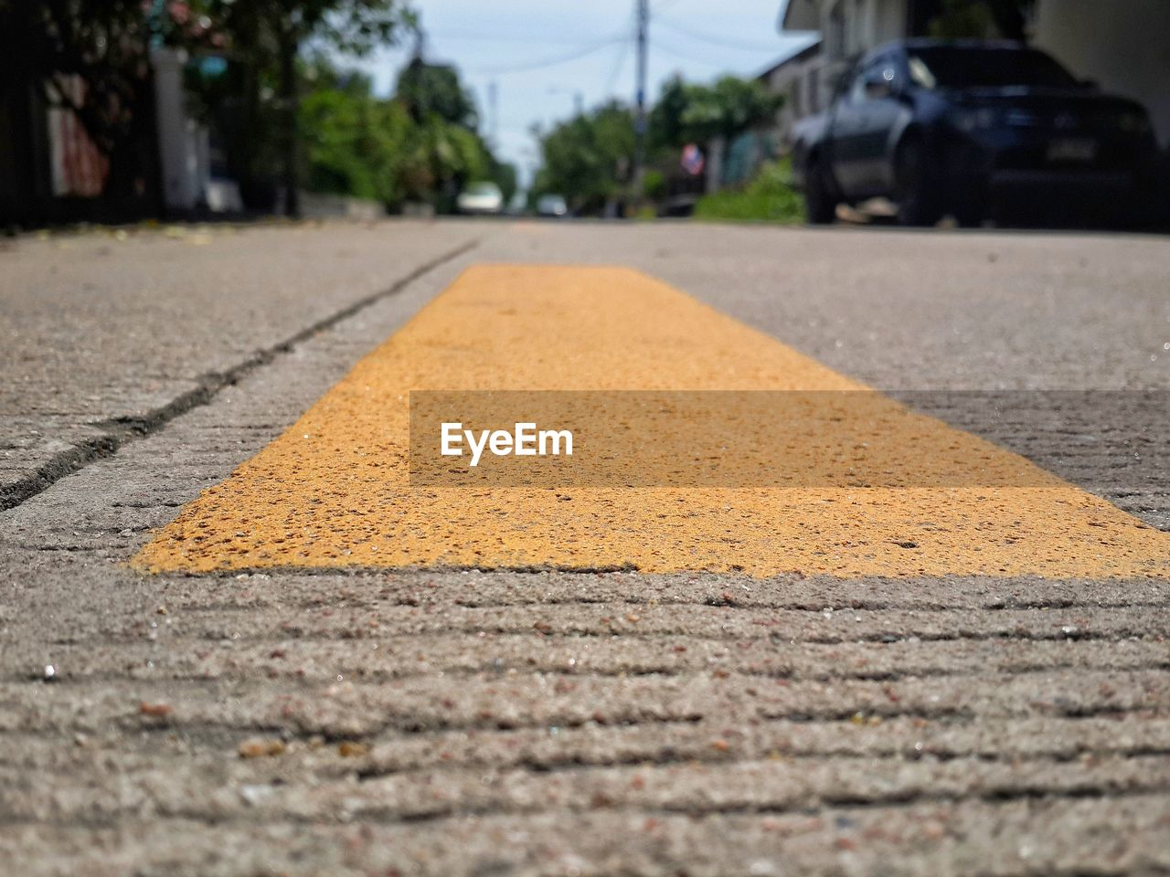 transportation, road, surface level, street, road marking, asphalt, the way forward, day, outdoors, land vehicle, no people, yellow, close-up