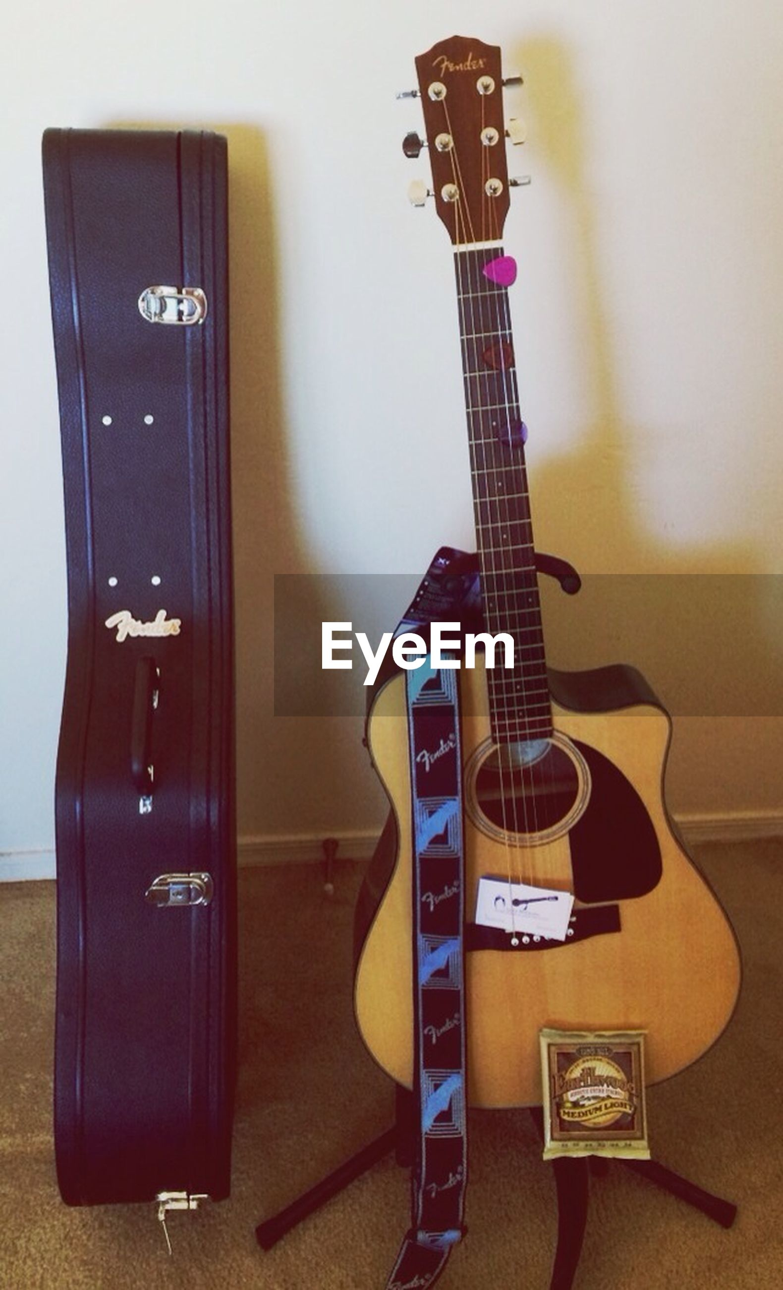 indoors, music, musical instrument, arts culture and entertainment, guitar, technology, musical equipment, still life, communication, musical instrument string, chair, table, string instrument, home interior, absence, acoustic guitar, old-fashioned, no people, wireless technology, audio equipment