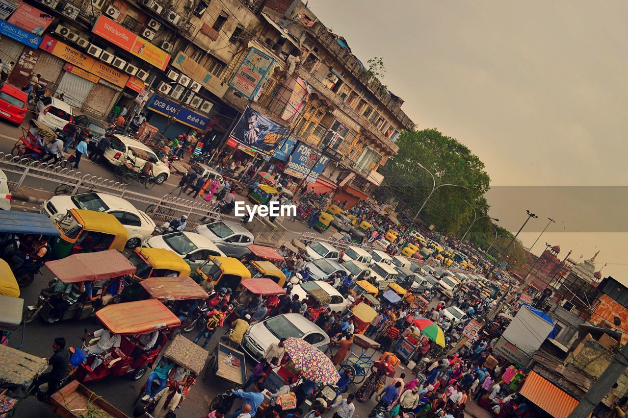 High angle view of people and vehicles on road in town
