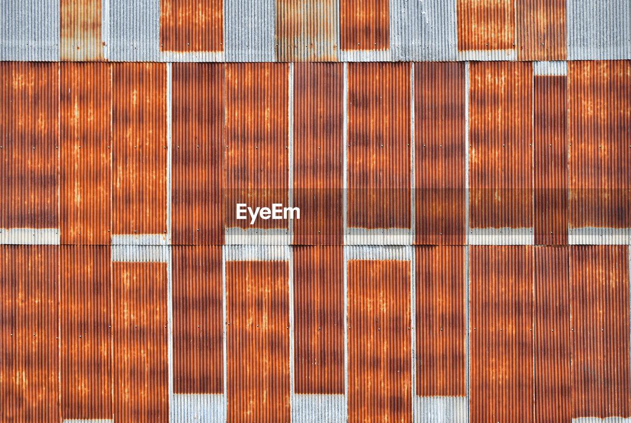 Full frame shot of rusty corrugated metallic wall