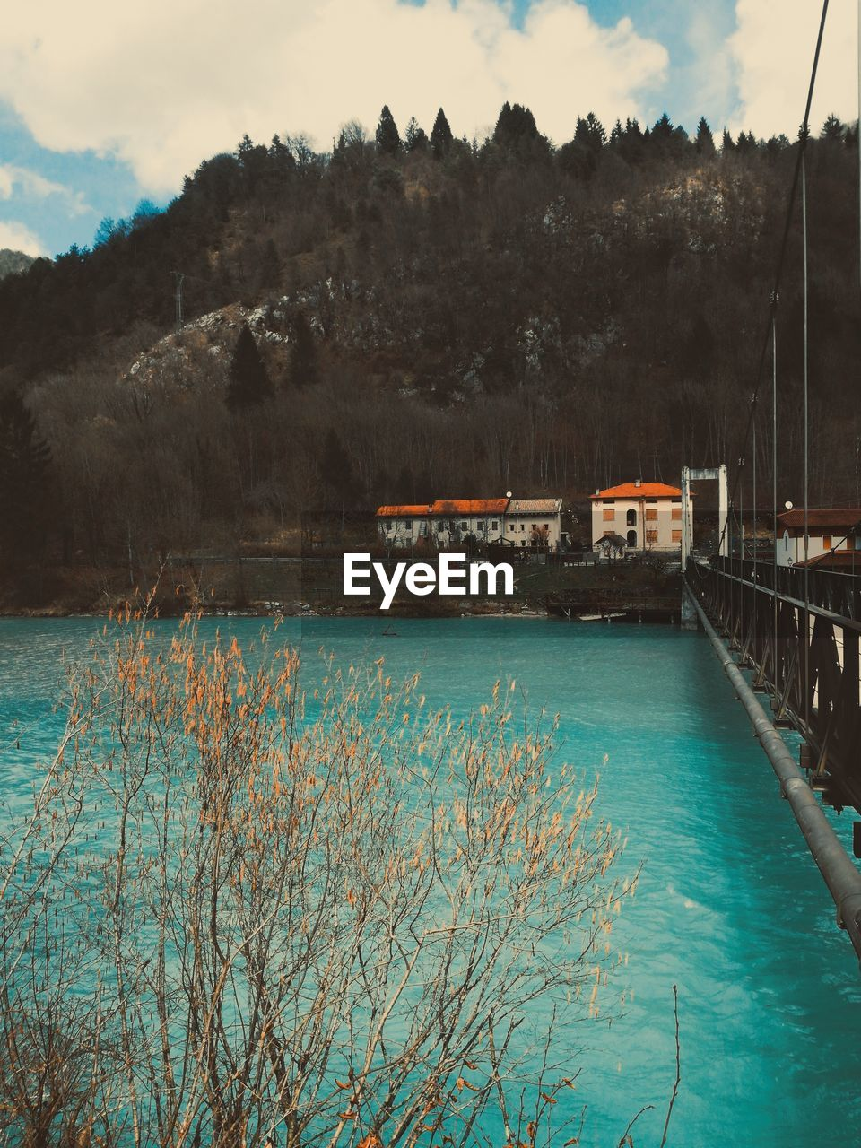 water, tree, sky, built structure, plant, architecture, nature, cloud - sky, beauty in nature, mountain, no people, scenics - nature, day, building exterior, transportation, tranquility, tranquil scene, outdoors, bridge, swimming pool