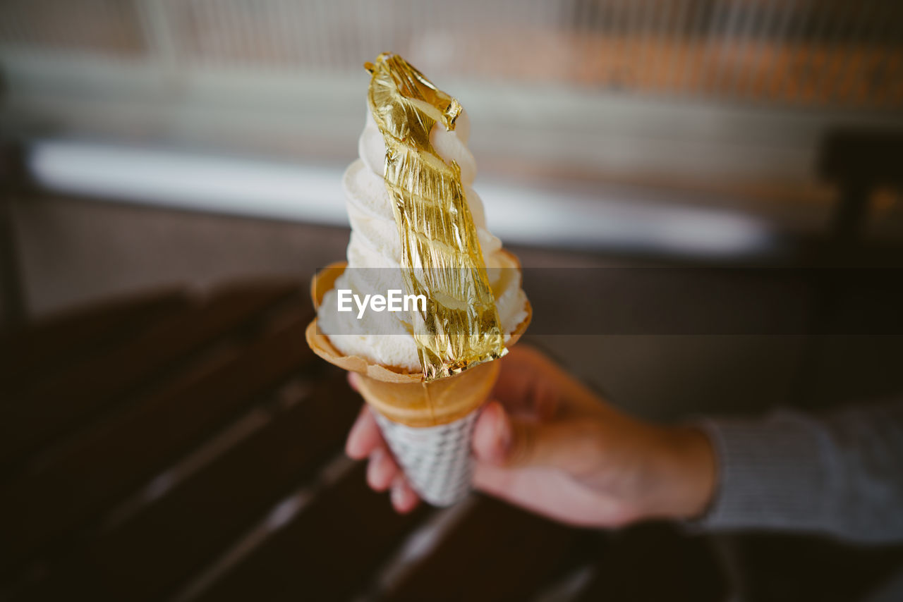Close-Up Of Hand Holding Ice Cream Cone