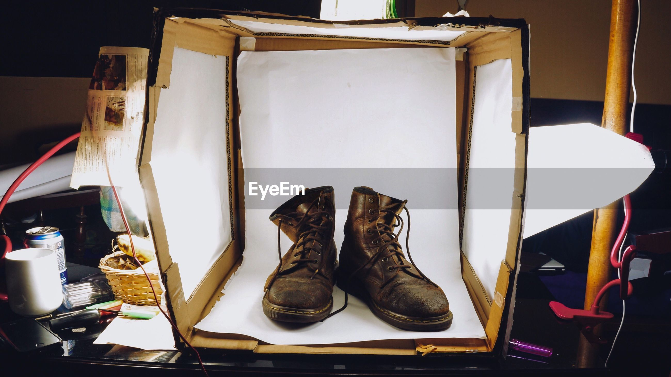 Close-up of shoes in box on table