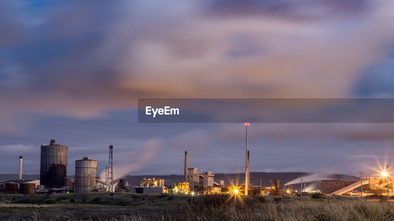 factory, building exterior, cloud - sky, built structure, industry, sky, architecture, fuel and power generation, nature, no people, industrial building, illuminated, smoke stack, environmental issues, outdoors, smoke - physical structure, environment, pollution, emitting, technology, air pollution, chemical plant