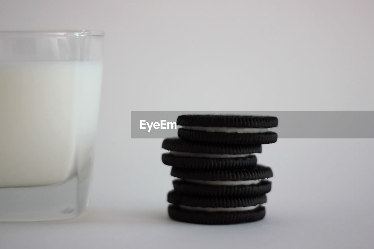 stack, indoors, glass, close-up, copy space, table, food and drink, no people, still life, drinking glass, white background, studio shot, household equipment, white color, food, dairy product, drink, milk, transparent, group of objects, clean, crockery