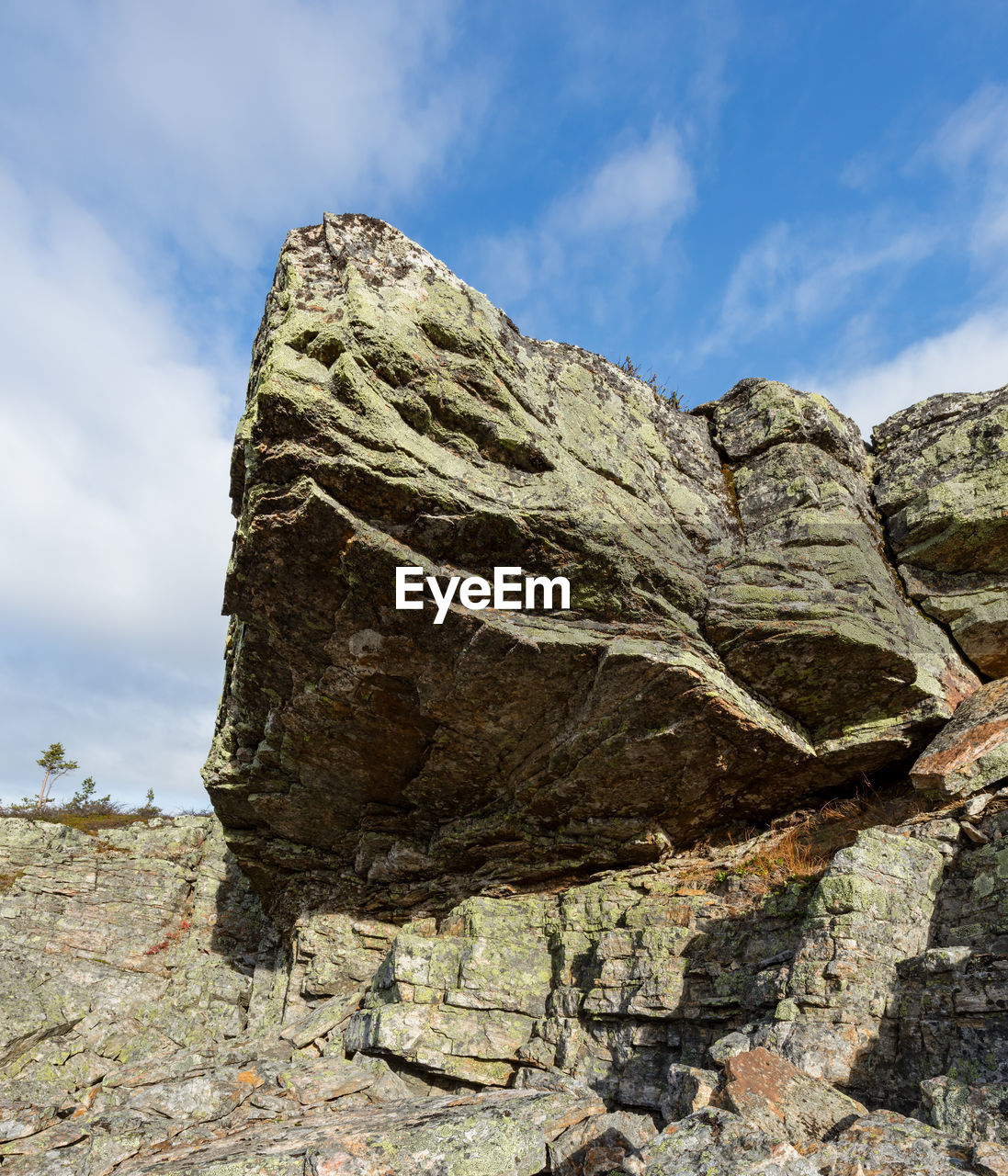 rock - object, rock formation, geology, sky, physical geography, day, low angle view, nature, cloud - sky, tranquil scene, tranquility, scenics, beauty in nature, outdoors, mountain, no people, travel destinations, cliff