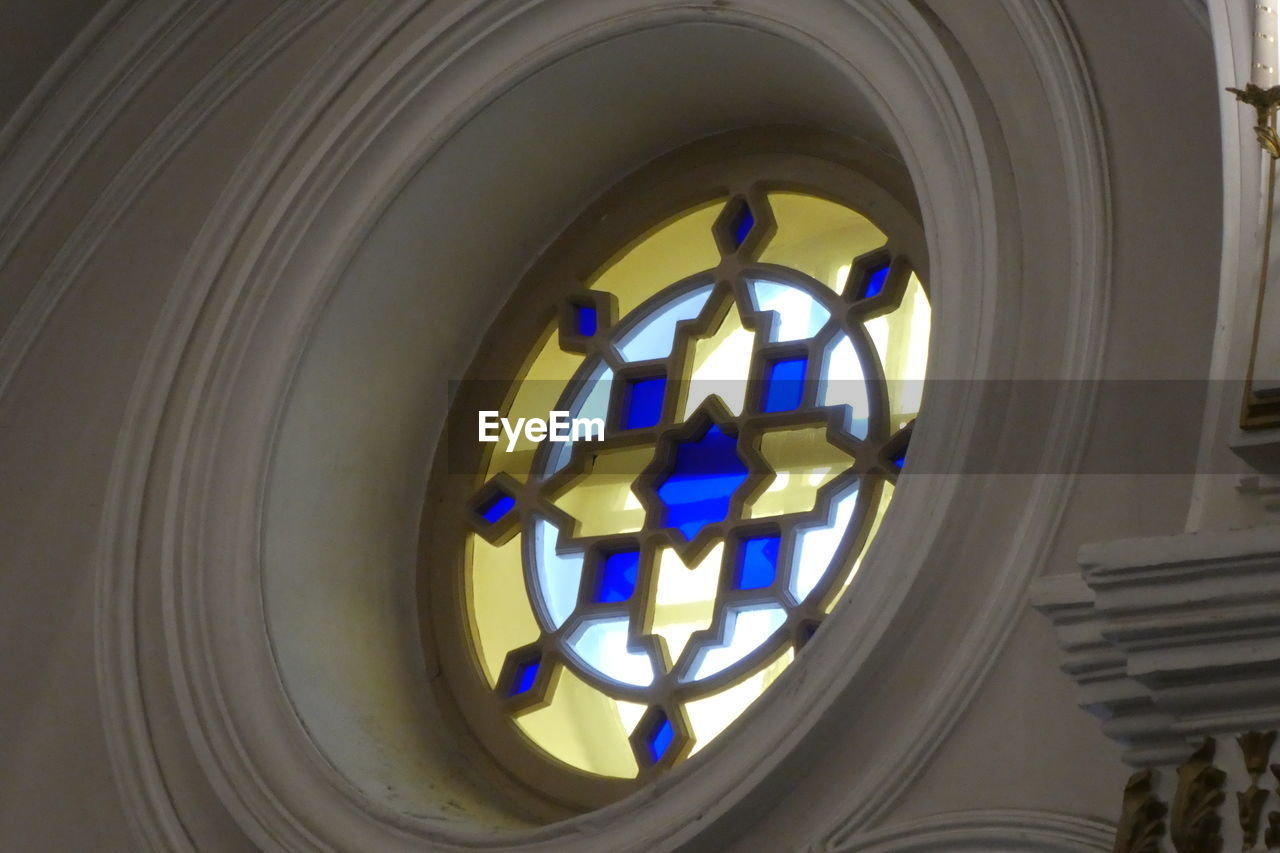 indoors, no people, shape, geometric shape, circle, architecture, pattern, design, built structure, low angle view, close-up, religion, illuminated, belief, place of worship, window, building, glass - material, day, ceiling, directly below