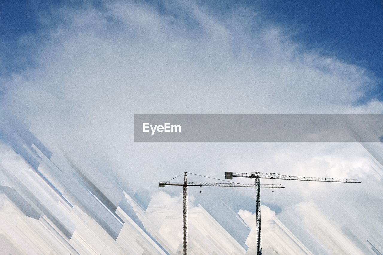 sky, cloud - sky, day, architecture, nature, low angle view, no people, built structure, building exterior, outdoors, construction industry, sunlight, cold temperature, snow, building, machinery, white color, development, beauty in nature, construction equipment