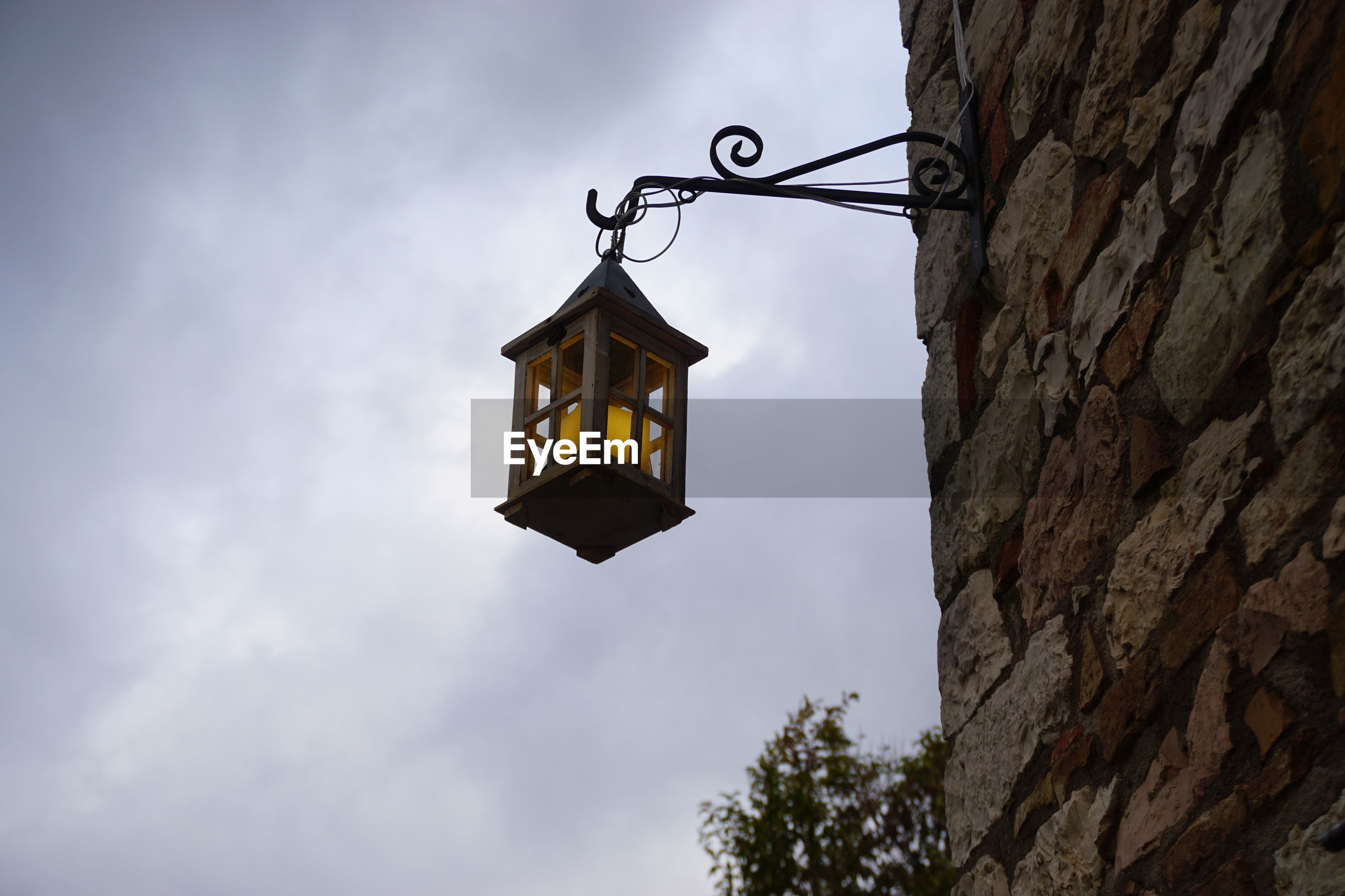 LOW ANGLE VIEW OF ILLUMINATED LANTERN AGAINST SKY
