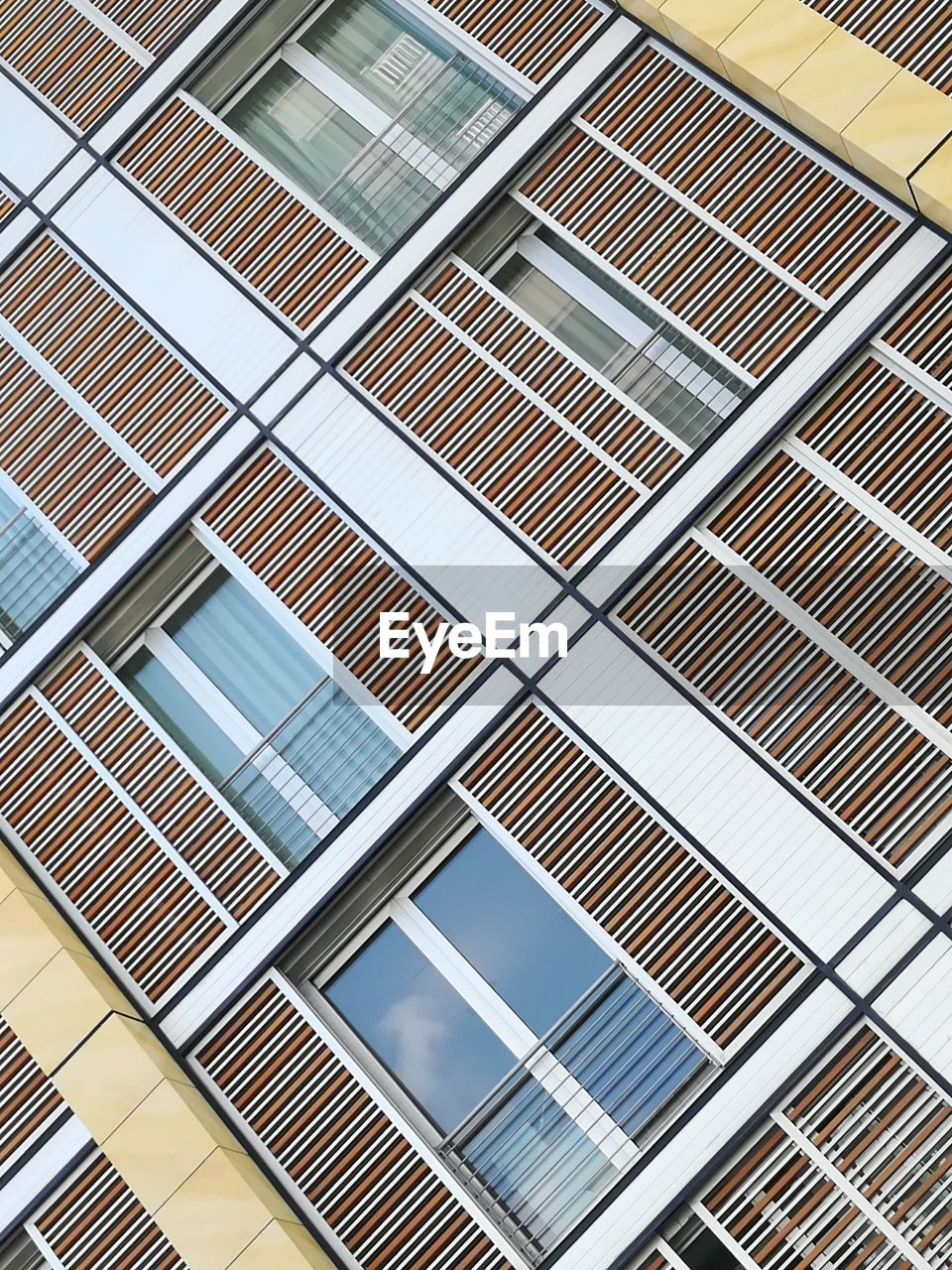 pattern, built structure, architecture, building, no people, low angle view, full frame, glass - material, building exterior, backgrounds, day, design, window, shape, in a row, metal, modern, geometric shape, office building exterior