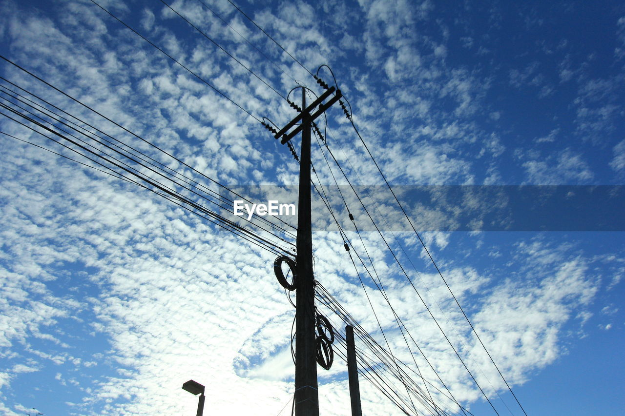 cloud - sky, sky, low angle view, cable, electricity, power line, electricity pylon, technology, connection, day, power supply, no people, nature, fuel and power generation, silhouette, outdoors, pole, communication, power cable, tree, directly below, telephone line