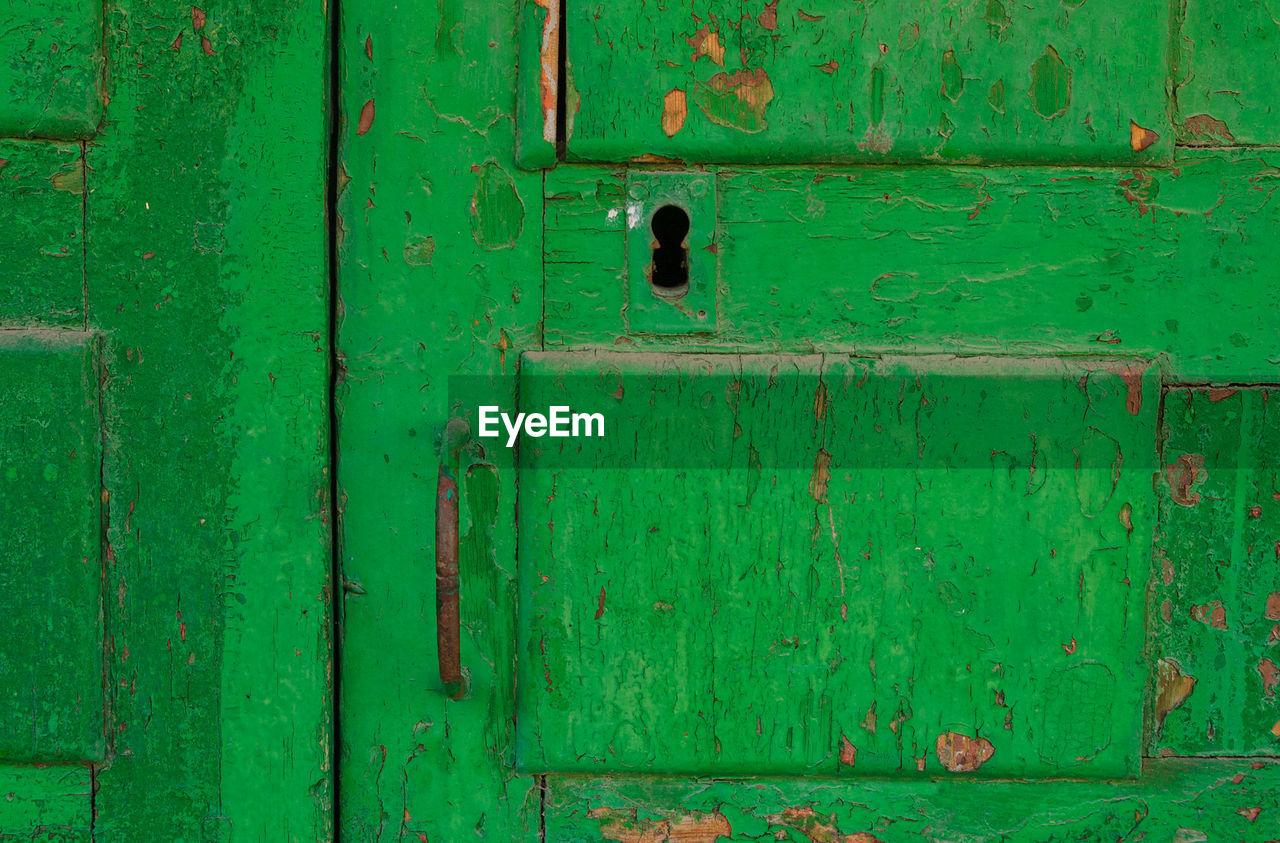 FULL FRAME SHOT OF GREEN DOOR WITH CLOSED DOORS