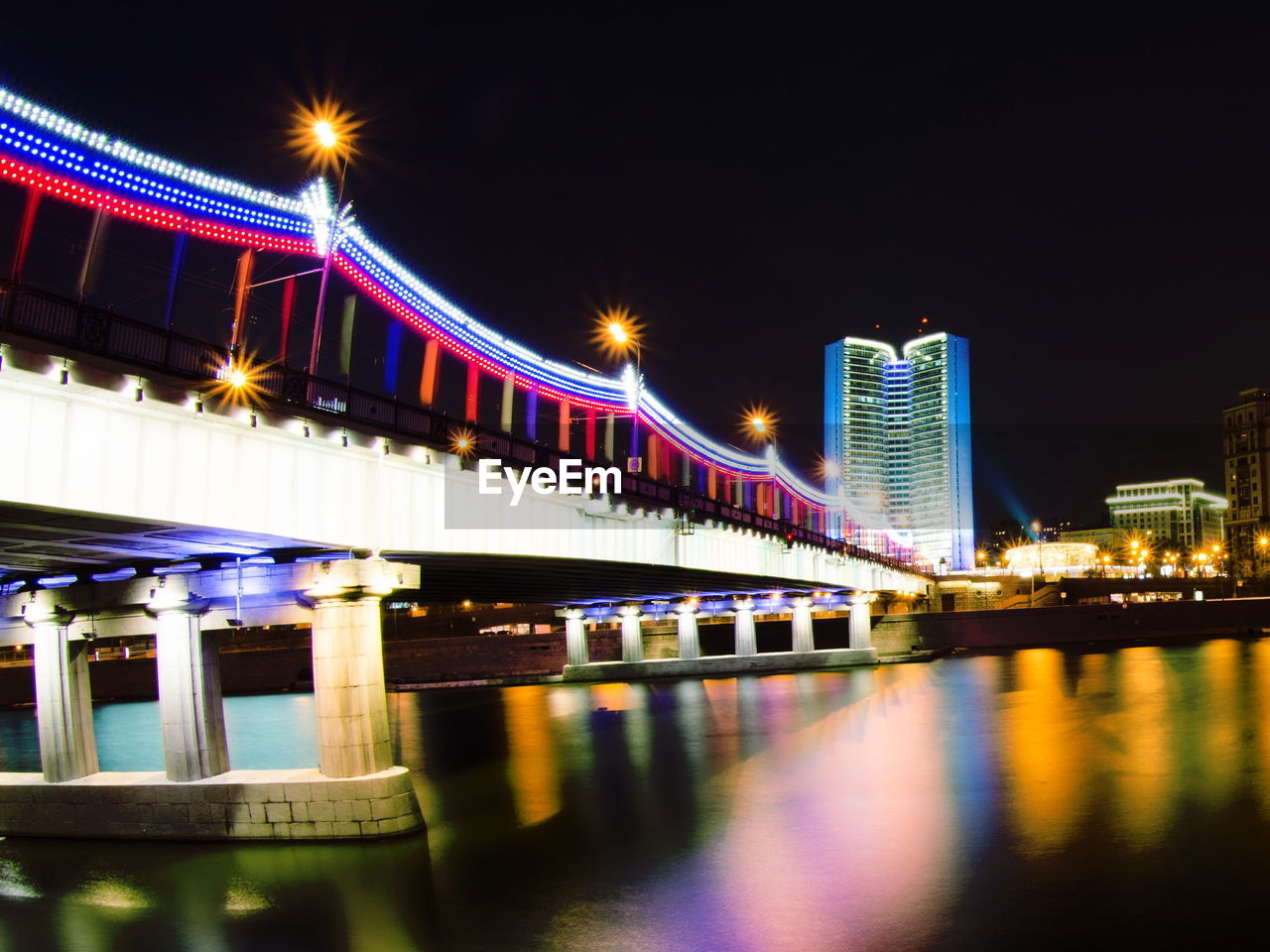 illuminated, night, architecture, built structure, building exterior, river, reflection, waterfront, water, bridge - man made structure, transportation, no people, city, outdoors, sky