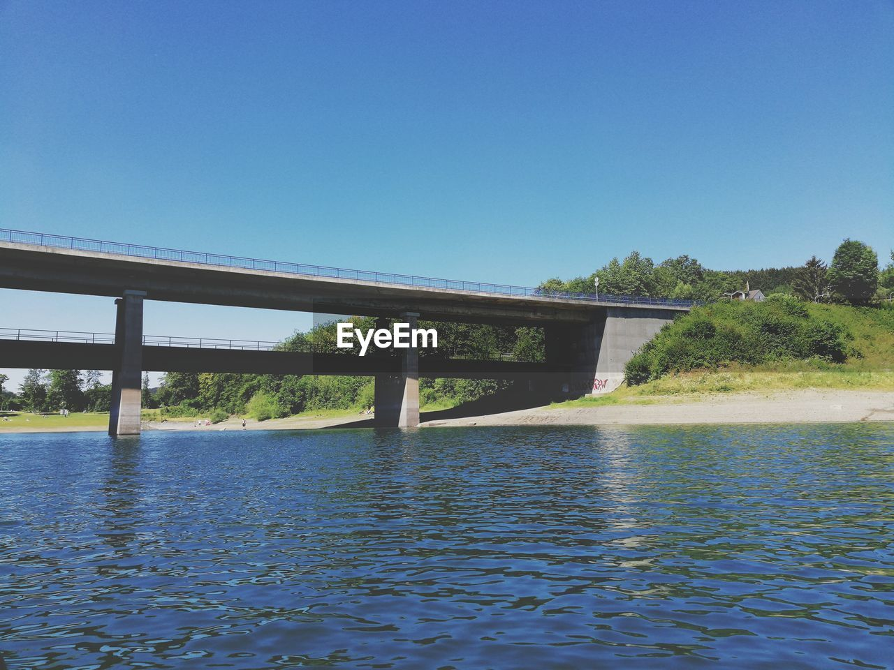 water, sky, bridge, built structure, clear sky, architecture, bridge - man made structure, copy space, connection, blue, river, nature, no people, waterfront, day, scenics - nature, tree, plant, transportation, outdoors, architectural column, flowing water, swimming pool