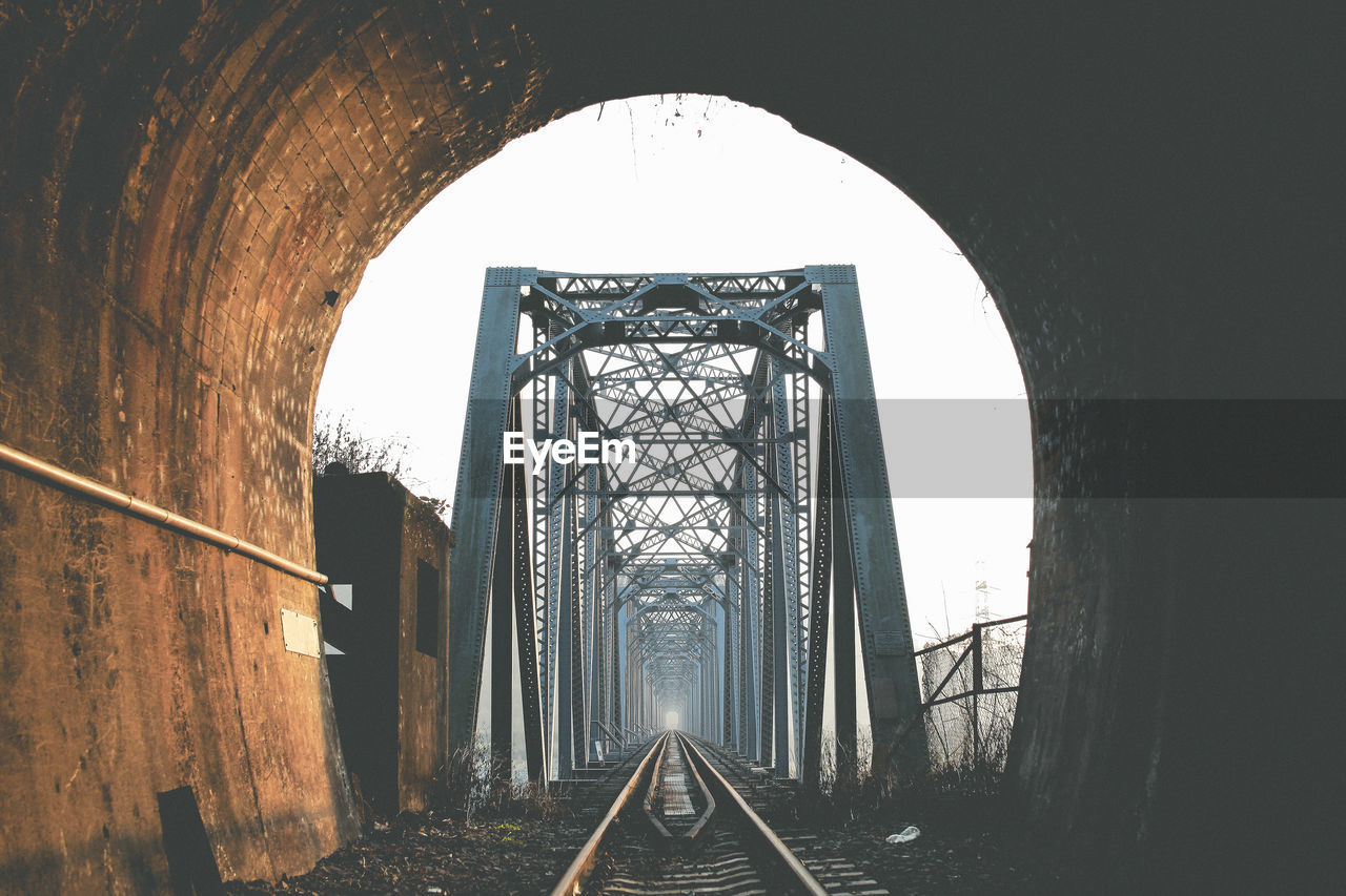 Railroad Bridge Seen Through Tunnel
