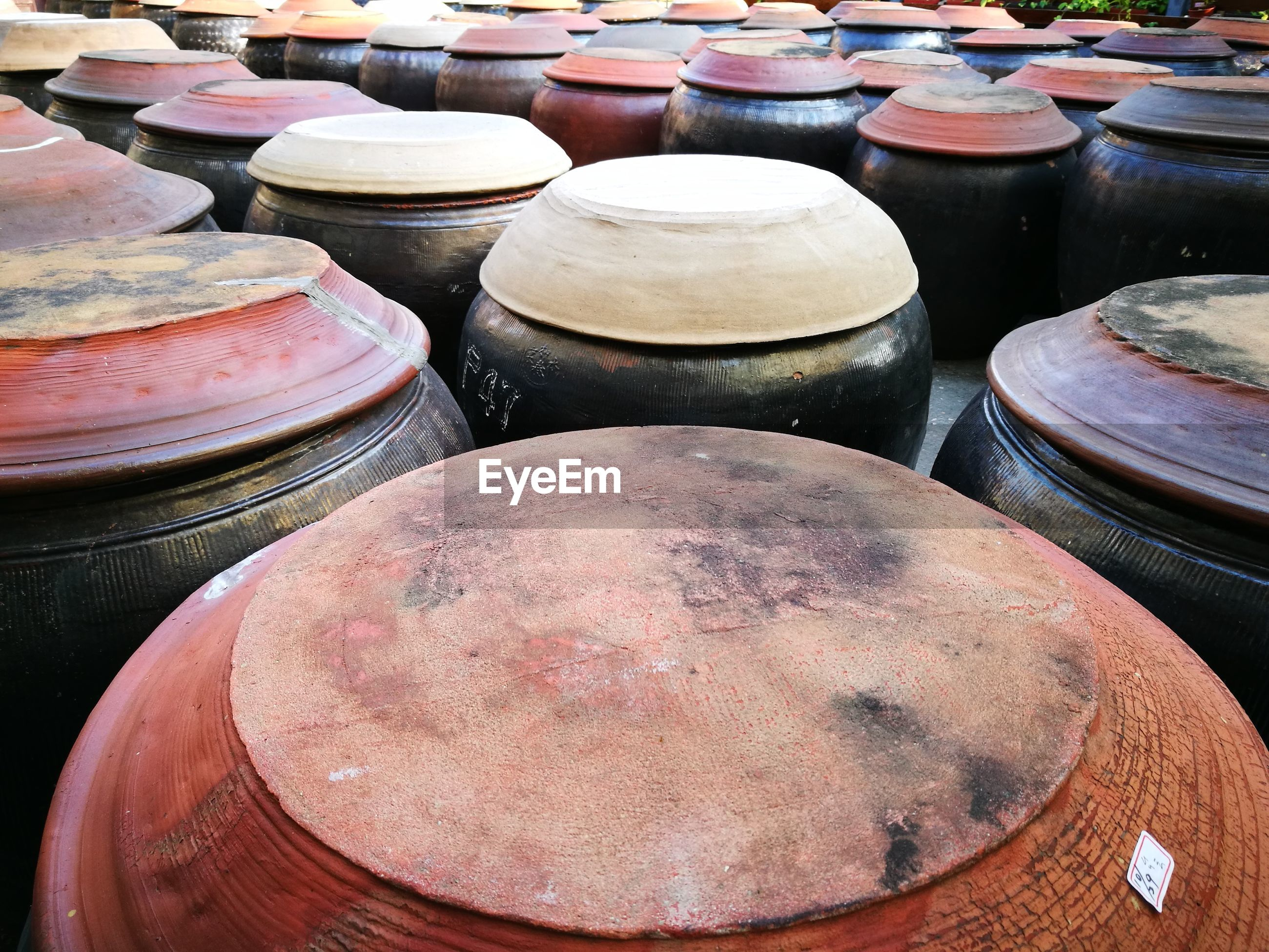 High angle view of barrels in market for sale