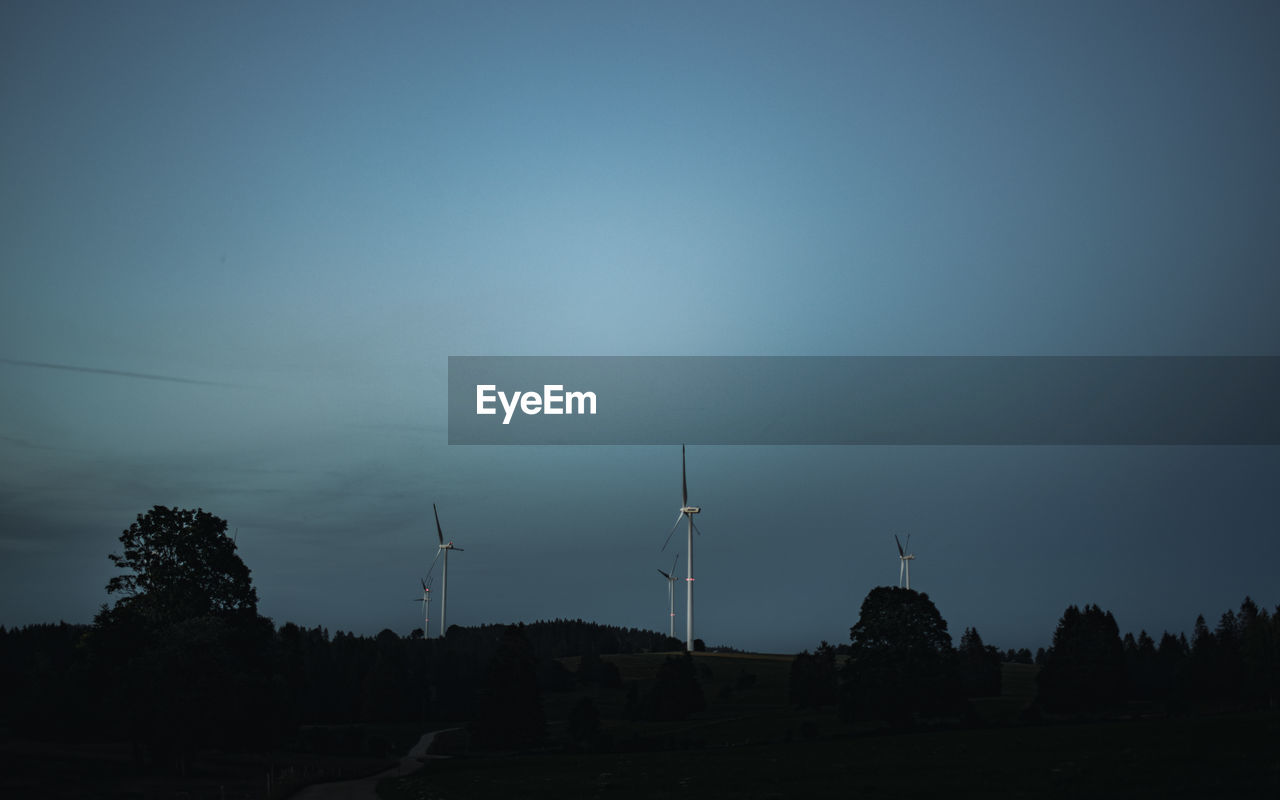 sky, environment, turbine, wind turbine, fuel and power generation, wind power, renewable energy, alternative energy, environmental conservation, tree, nature, no people, technology, landscape, silhouette, plant, land, field, copy space, low angle view, outdoors, electricity, sustainable resources, power supply