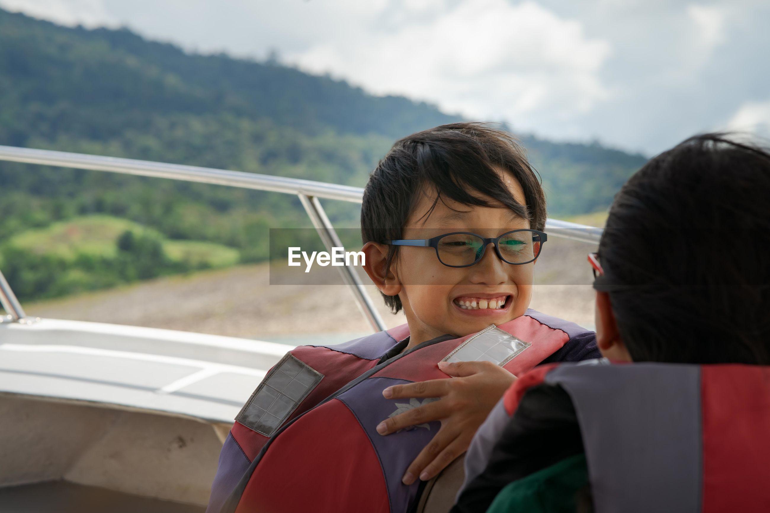 Girls wearing life jackets in boat