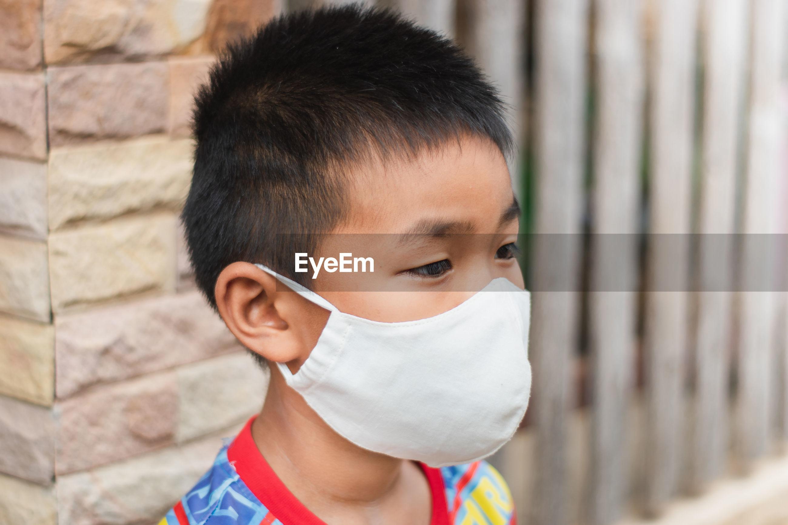 Close-up of boy wearing mask