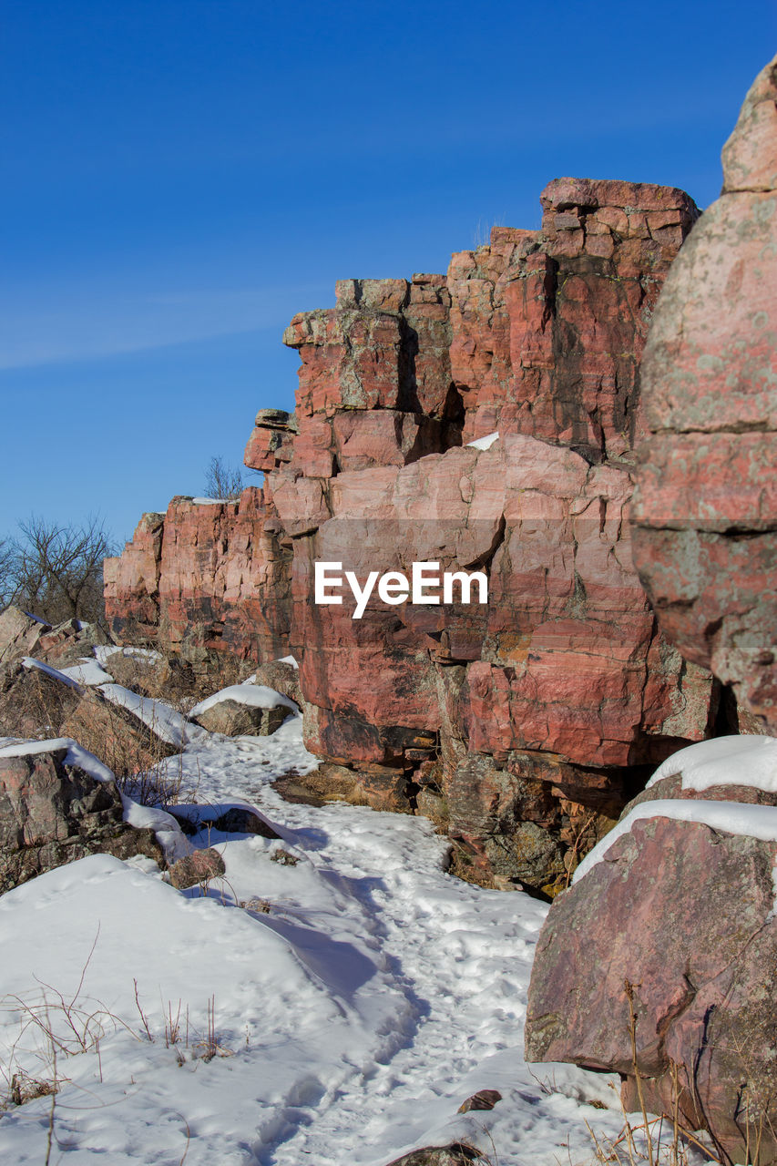 rock, rock - object, sky, solid, nature, beauty in nature, winter, no people, rock formation, cold temperature, tranquility, day, scenics - nature, mountain, tranquil scene, non-urban scene, blue, clear sky, snow, outdoors, formation, eroded, climate