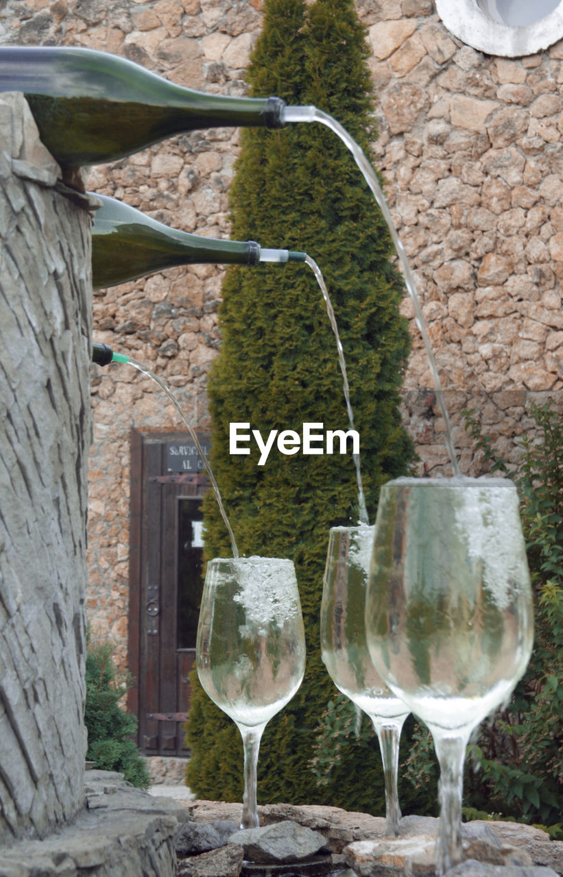 WINE GLASS AGAINST BUILT STRUCTURE AND WALL