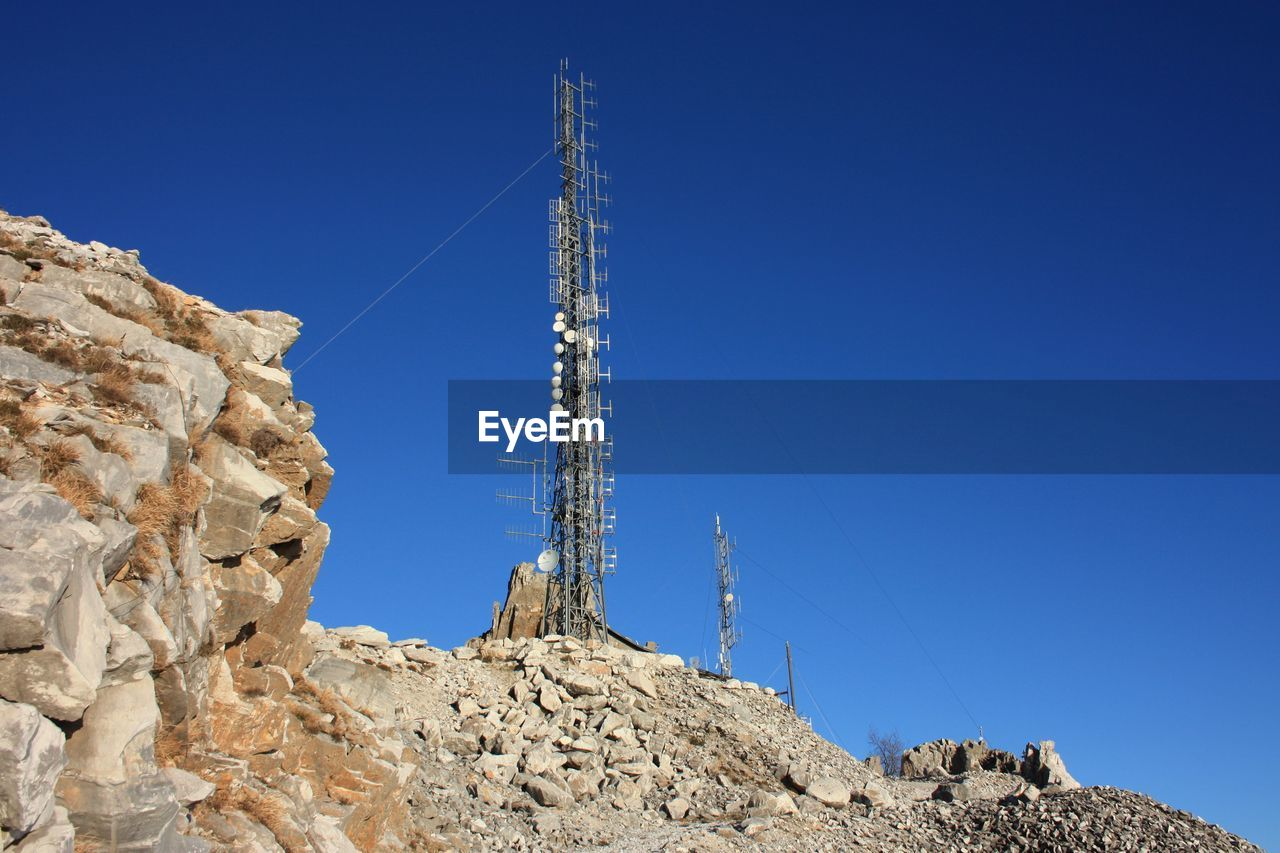 Communication, telecommunication and television antennas, positioned of the mountains at the top.