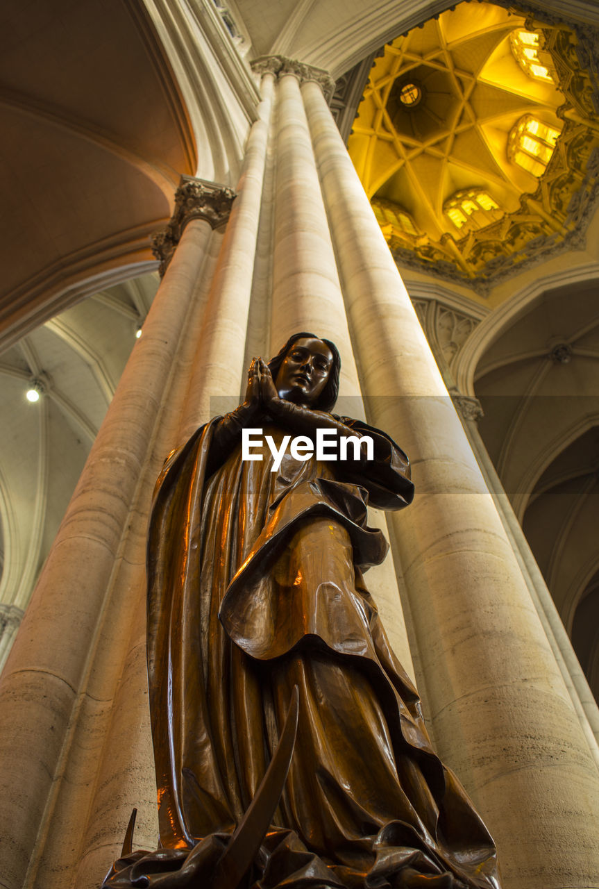 Low Angle View Of Statue By Column