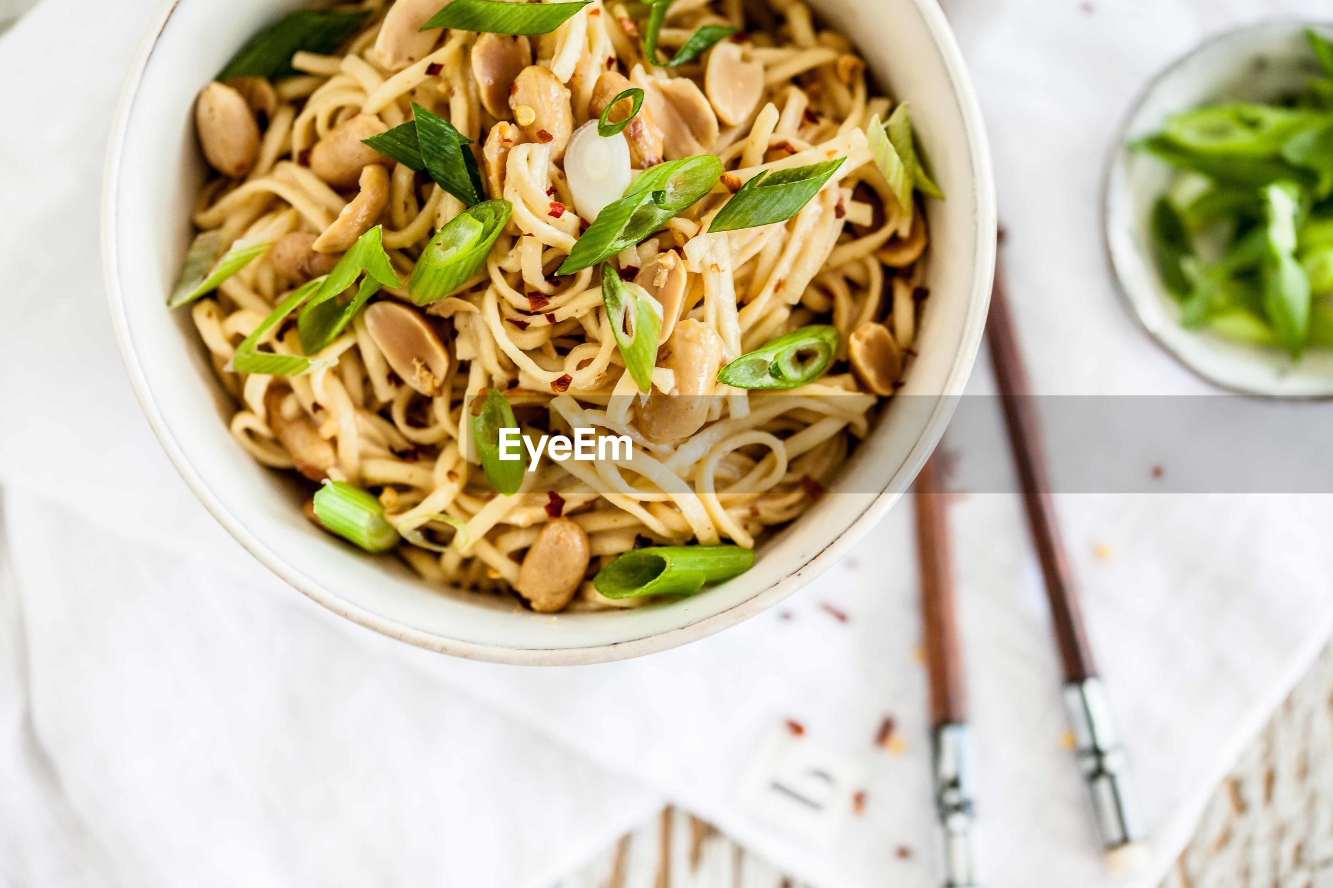Close-up of fried noodles in bowl on table