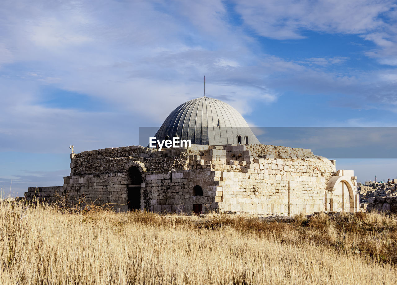 built structure, building exterior, architecture, sky, dome, cloud - sky, nature, plant, field, history, day, land, grass, the past, religion, building, place of worship, no people, belief, spirituality, outdoors, ruined