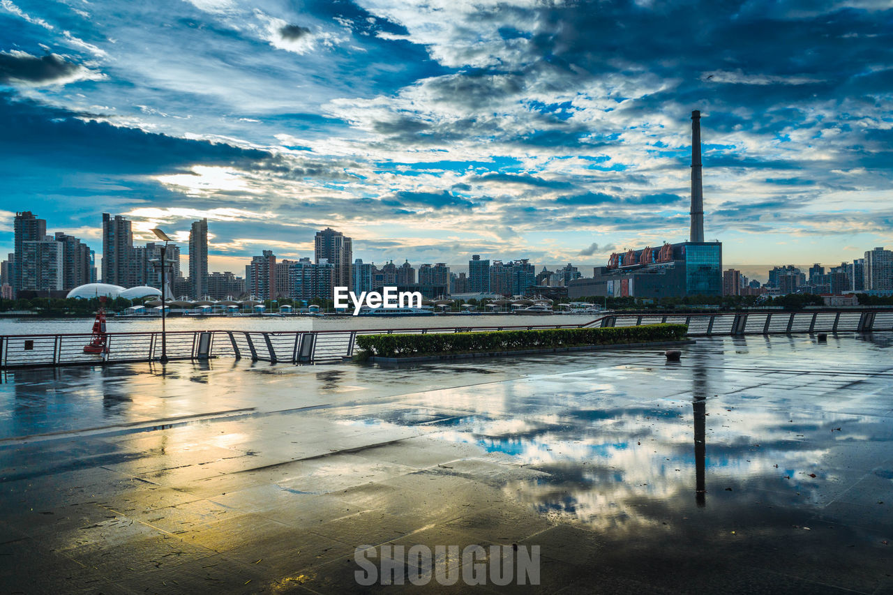 architecture, city, skyscraper, building exterior, built structure, cityscape, water, sky, reflection, cloud - sky, urban skyline, modern, city life, outdoors, waterfront, river, travel destinations, no people, day, nature