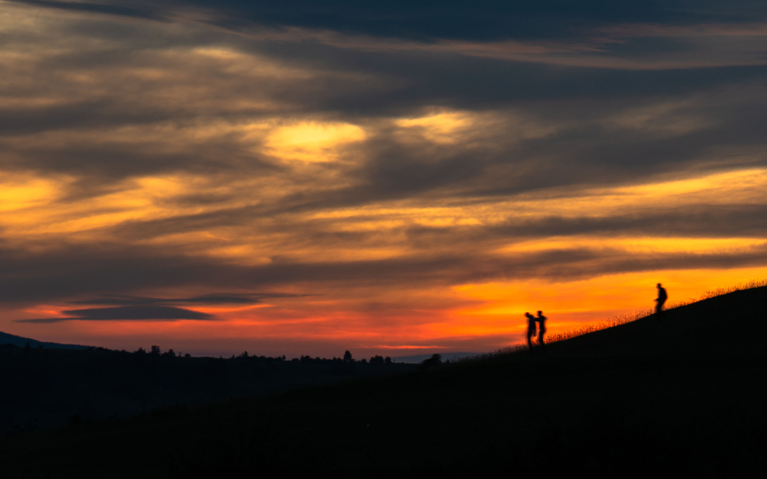 SILHOUETTE PEOPLE ON LAND DURING SUNSET